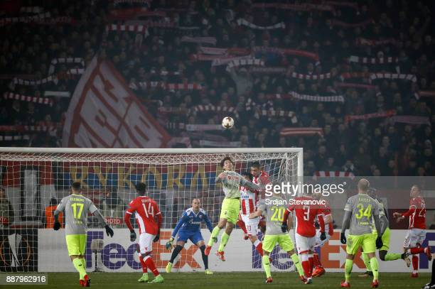 Yuya Osako of FC Koeln jump for the ball against Vujadin Savic of Crvena Zvezda during the UEFA Europa League group H match between Crvena Zvezda and...