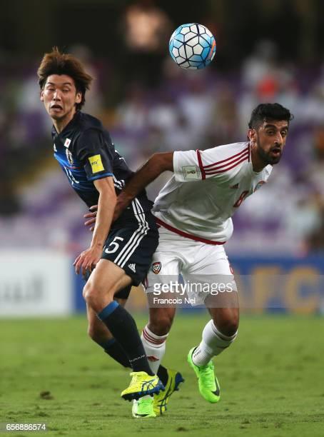 Yuya Osako of Japan and Hamdan AlKamali of United Arab Emirates battle for the ball during the FIFA 2018 World Cup qualifying match between United...