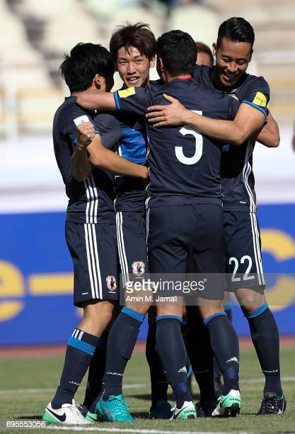Yuya Osako of Japan and players of Japan celebrate after first goal during the FIFA World Cup Russia Asian Final Qualifier match between Iraq and...
