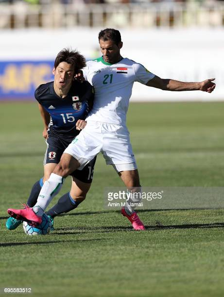Yuya Osako of Japan and Saad Abdolameer of Iraq in action during the FIFA World Cup Russia Asian Final Qualifier match between Iraq and Japan at PAS...
