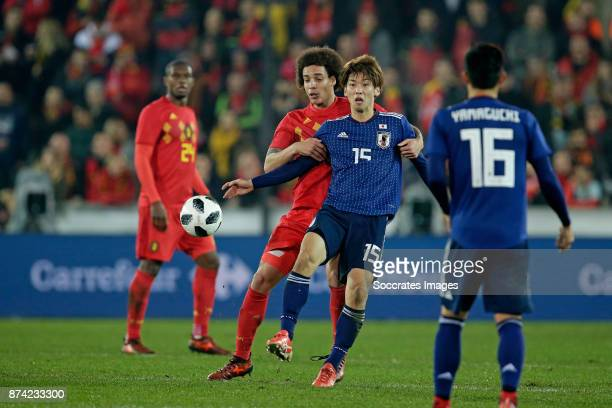 Yuya Osako of Japan Axel Witsel of Belgium during the International Friendly match between Belgium v Japan at the Jan Breydel Stadium on November 14...