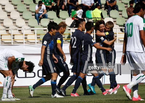 Yuya Osako of Japan celebrates after scoring a goal during the 2018 FIFA World Cup Asian Qualifying group B football match between Iraq and Japan at...