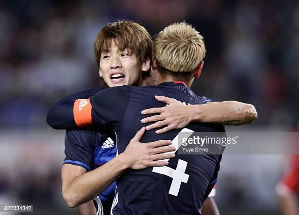 Yuya Osako of Japan celebrates scoring his team's first goal with his team mate Keisuke Honda during the international friendly match between Japan...