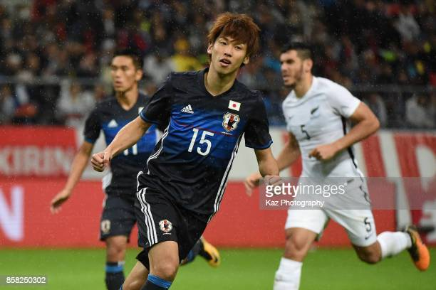 Yuya Osako of Japan celebrates scoring the opening goal from the penalty spot during the international friendly match between Japan and New Zealand...