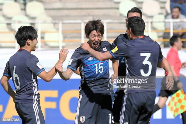 Yuya Osako of Japan celebrates scoring the opening goal with his team mates during the FIFA World Cup Russia Asian Final Qualifier match between Iraq...