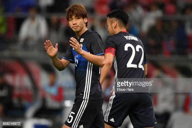 Yuya Osako of Japan celebrates scoring the opening goal with his team mate Maya Yoshida during the international friendly match between Japan and New...