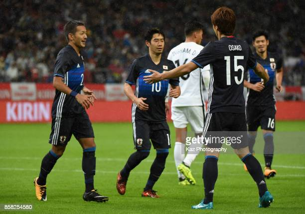 Yuya Osako of Japan celebrates scoring the opening goal with his team mates during the international friendly match between Japan and New Zealand at...