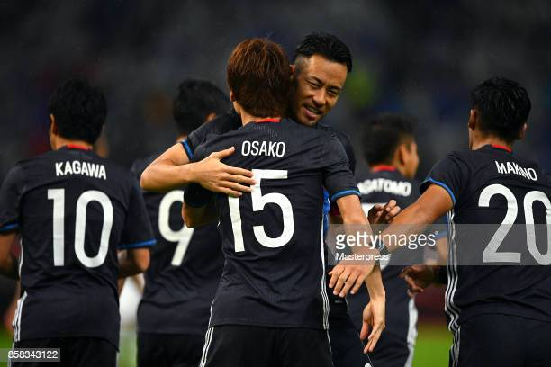 Yuya Osako of Japan celebrates scoring the opening goal with his team mate Maya Yoshida during the international friendly match between Japan and New...