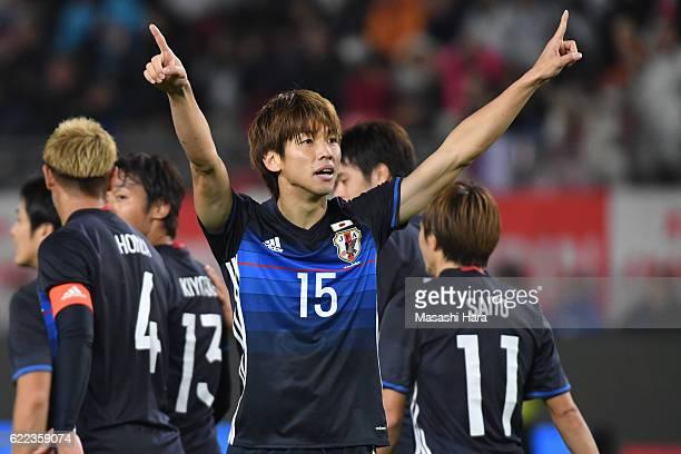 Yuya Osako of Japan celebrates the first goal during the international friendly match between Japan and Oman at Kashima Soccer Stadium on November 11...
