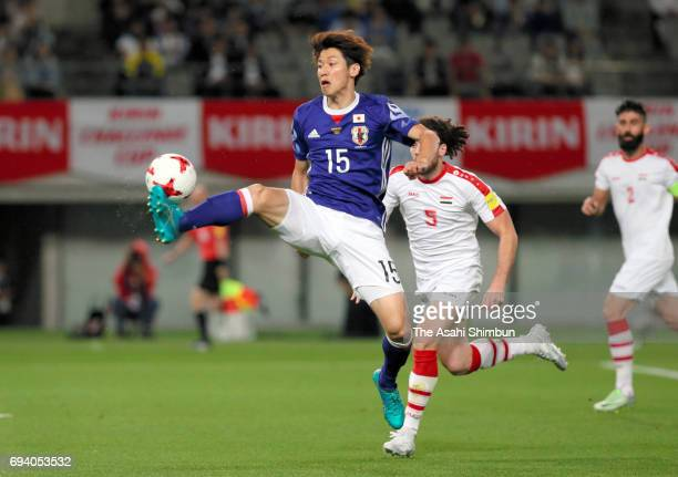 Yuya Osako of Japan controls the ball during the international friendly match between Japan and Syria at Tokyo Stadium on June 7 2017 in Chofu Tokyo...