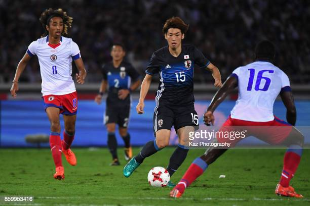 Yuya Osako of Japan controls the ball under pressure of Haiti defense during the international friendly match between Japan and Haiti at Nissan...