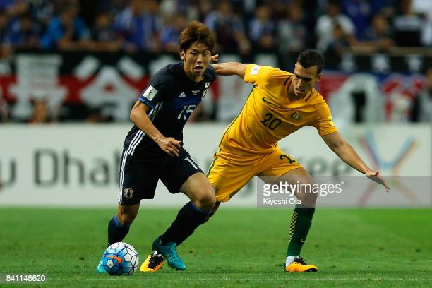 Yuya Osako of Japan controls the ball under pressure of Trent Sainsbury of Australia during the FIFA World Cup Qualifier match between Japan and...