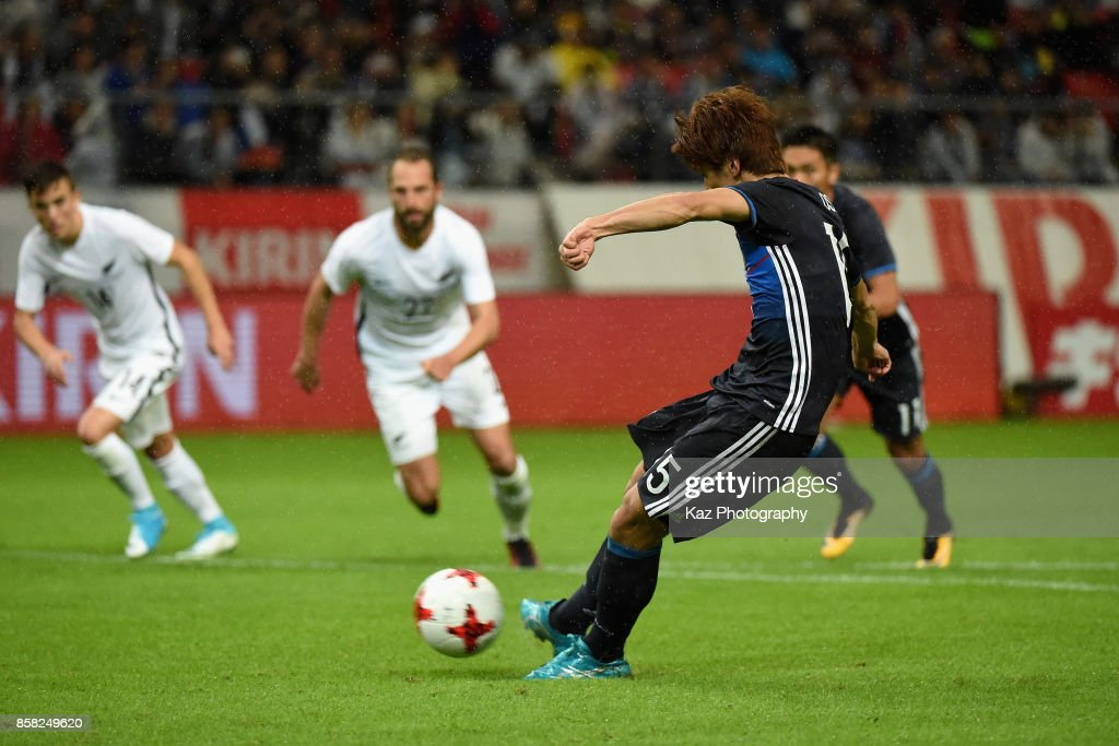 Yuya Osako of Japan converts the penalty to score the opening goal during the international friendly match between Japan and New Zealand at Toyota Stadium on October 6, 2017 in Toyota, Aichi, Japan.