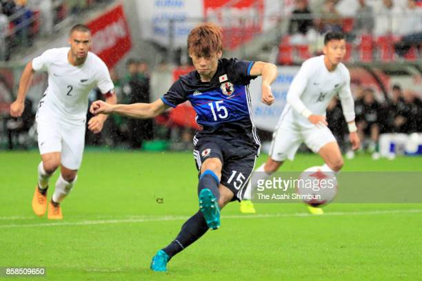 Yuya Osako of Japan converts the penalty to score the opening goal during the international friendly match between Japan and New Zealand at Toyota...