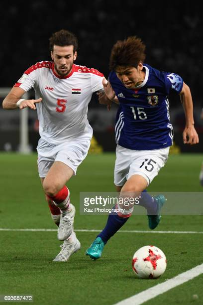 Yuya Osako of Japan dribbles the ball under the pressure from Omro Al Midani of Syria during the international friendly match between Japan and Syria...