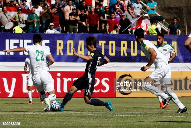 Yuya Osako of Japan in action against Rebin Ghareeb of Iraq during the 2018 FIFA World Cup Asian Qualifying group B football match between Iraq and...