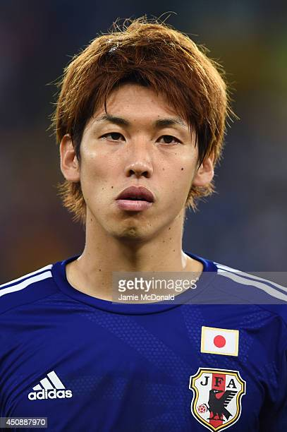 Yuya Osako of Japan looks on during the National Anthem prior to the 2014 FIFA World Cup Brazil Group C match between Japan and Greece at Estadio das...