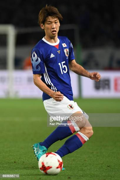 Yuya Osako of Japan passes the ball during the international friendly match between Japan and Syria at Tokyo Stadium on June 7 2017 in Chofu Tokyo...