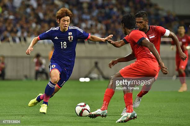 Yuya Osako of Japan runs with the ball during the 2018 FIFA World Cup Asian Qualifier second round match between Japan and Singapore at Saitama...