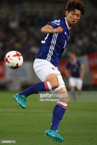 Yuya Osako of Japan trapps the ball during the international friendly match between Japan and Syria at Tokyo Stadium on June 7 2017 in Chofu Tokyo...