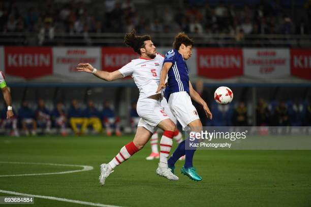 Yuya Osako of Japan trapps the ball under the pressure from Omro Al Midani of Syria during the international friendly match between Japan and Syria...