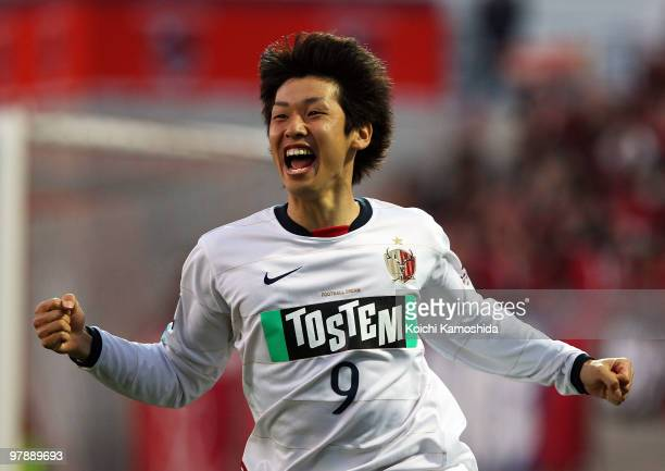 Yuya Osako of Kashima Antlers celebrates after scoring his team's first goal during the JLeague match between Omiya Ardija and Kashima Antlers at...