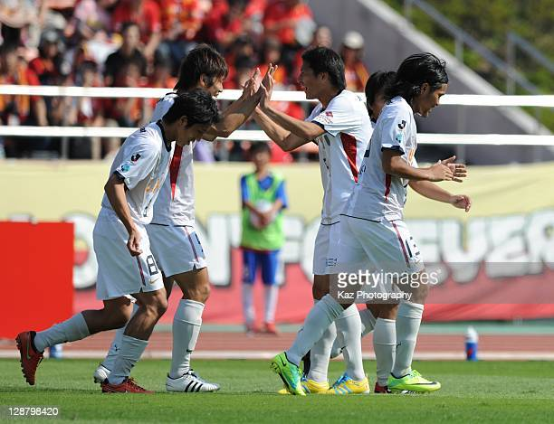 Yuya Osako of Kashima Antlers celebrates with his team mates after scoring his opener during the Yamazaki Nabisco Cup semifinal match between Nagoya...