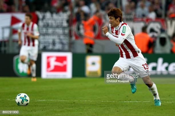 Yuya Osako of Kln runs with the ball during the Bundesliga match between 1 FC Koeln and Eintracht Frankfurt at RheinEnergieStadion on September 20...