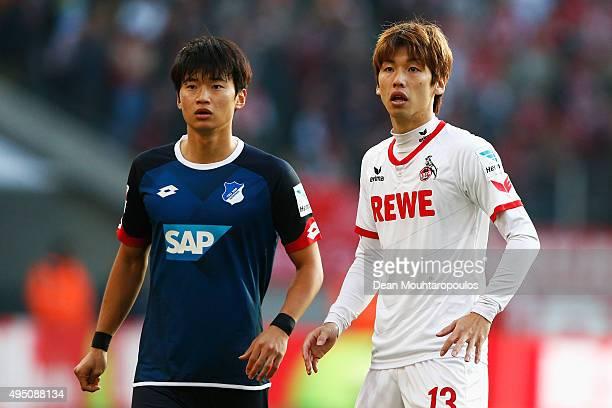 Yuya Osako of koeln and Kim Jinsu of Hoffenheim look on during the Bundesliga match between 1 FC Koeln and TSG 1899 Hoffenheim held at...