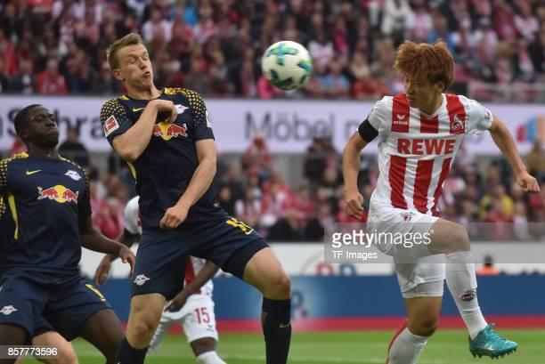 Yuya Osako of Koeln and Lukas Klostermann and Ibrahima Konate of Leipzig battle for the ball during the Bundesliga match between 1 FC Koeln and RB...