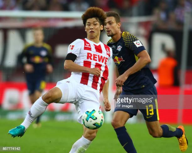 Yuya Osako of Koeln and Stefan Ilsanker of Leipzig battle for the ball during the Bundesliga match between 1 FC Koeln and RB Leipzig at...