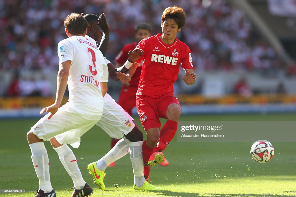 <a gi-track='captionPersonalityLinkClicked' href=/galleries/search?phrase=Yuya+Osako&family=editorial&specificpeople=5765568 ng-click='$event.stopPropagation()'>Yuya Osako</a> (R) of Koeln battles for the ball with Antonio Ruediger of Stuttgart and his team mate <a gi-track='captionPersonalityLinkClicked' href=/galleries/search?phrase=Daniel+Schwaab&family=editorial&specificpeople=686549 ng-click='$event.stopPropagation()'>Daniel Schwaab</a> (L) during the Bundesliga match between VfB Stuttgart and 1. FC Koeln at Mercedes-Benz Arena on August 30, 2014 in Stuttgart, Germany.