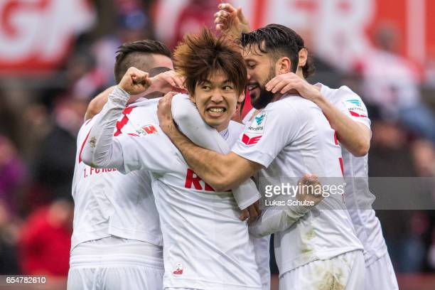 Yuya Osako of Koeln celebrates his teams first goal with teammates during the Bundesliga match between 1 FC Koeln and Hertha BSC at...