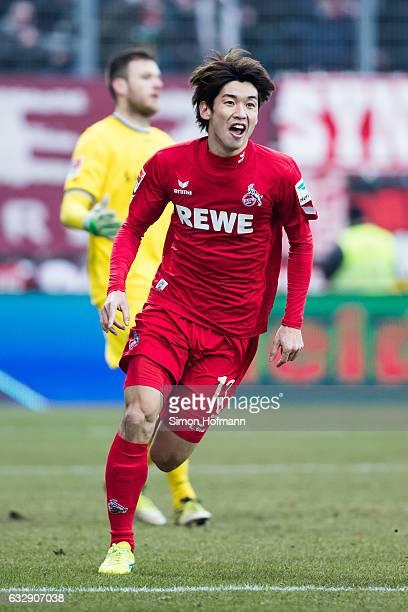 Yuya Osako of Koeln celebrates his team's second goal during the Bundesliga match between SV Darmstadt 98 and 1 FC Koeln at JonathanHeimesStadion am...