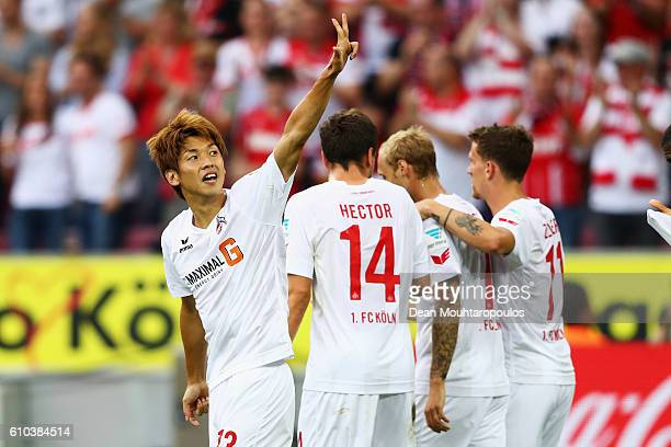 Yuya Osako of Koeln celebrates scoring his teams first goal of the game with team mates during the Bundesliga match between 1 FC Koeln and RB Leipzig...
