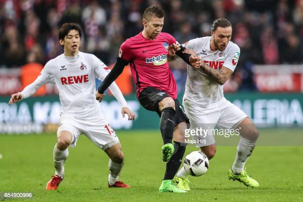 Yuya Osako of Koeln Mitchell Weiser of Berlin and Marco Hoeger of Koeln battle for the ball during the Bundesliga match between 1 FC Koeln and Hertha...