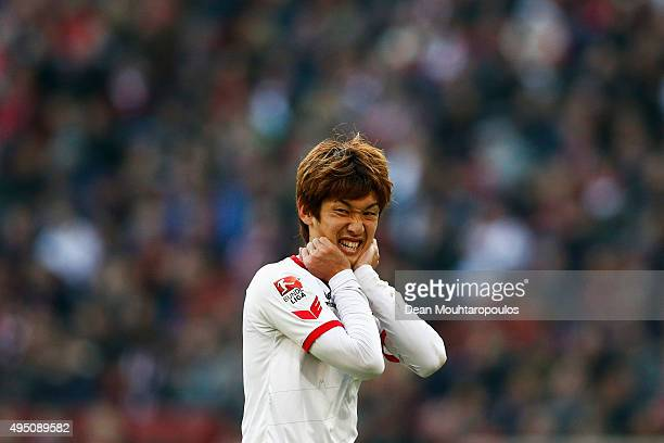 Yuya Osako of koeln reacts to a missed chance on goal during the Bundesliga match between 1 FC Koeln and TSG 1899 Hoffenheim held at...