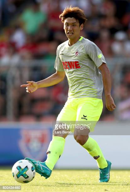 Yuya Osako of Koeln runs with the ball during the preseason friendly match between KFC Uerdingen and 1 FC Koeln at on July 21 2017 in Krefeld Germany