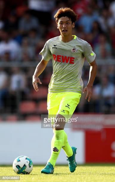 Yuya Osako of Koeln runs with the ball during the preseason friendly match between KFC Uerdingen and 1 FC Koeln at on July 21 2017 in Krefeld Germany