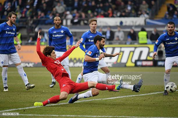 Yuya Osako of Koeln scores his team's first goal during the Bundesliga match between SV Darmstadt 98 and 1 FC Koeln at Stadion am Boellenfalltor on...