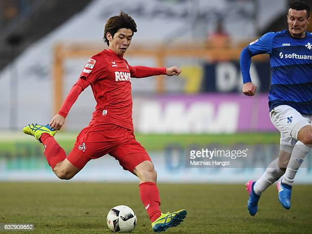 Yuya Osako of Koeln scores his team's fourth goal during the Bundesliga match between SV Darmstadt 98 and 1 FC Koeln at Stadion am Boellenfalltor on...