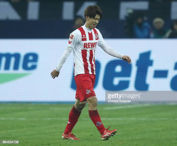 Yuya Osako of Koeln walks off after he received a red card during the Bundesliga match between FC Schalke 04 and 1 FC Koeln at VeltinsArena on...