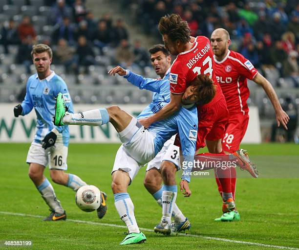 Yuya Osako of Munich is challenged by Adam Bodzek of Duesseldorf during the Second Bundesliga match between TSV 1860 Muenchen and Fortuna Duesseldorf...