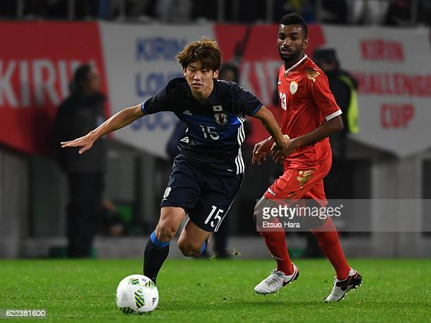 Yuya Osako#15 of Japan in action during the international friendly match between Japan and Oman at Kashima Soccer Stadium on November 11 2016 in...