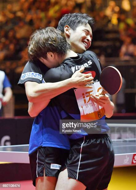 Yuya Oshima and Masataka Morizono of Japan celebrate after reaching the men's doubles final at the world table tennis championships in Dusseldorf...