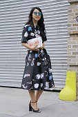 Yuyu Zhangzou is seen on the streets of Manhattan outside of the Lie Sangbong Spring 2016 fashion show at Skylight at Moynihan Station wearing...