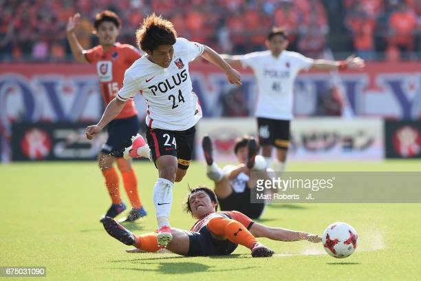 Yuzo Iwakami of Omiya Ardija competes for the ball against Takahiro Sekine of Urawa Red Diamonds during the JLeague J1 match between Omiya Ardija and...