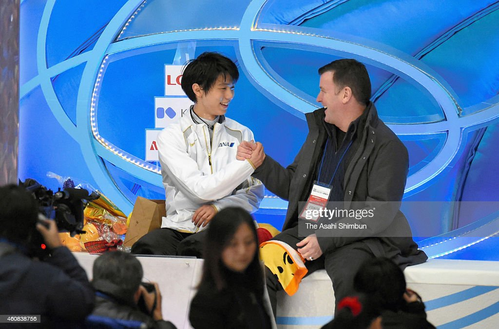 Yuzuru Hanyu and his coach <a gi-track='captionPersonalityLinkClicked' href=/galleries/search?phrase=Brian+Orser&family=editorial&specificpeople=1138867 ng-click='$event.stopPropagation()'>Brian Orser</a> shake hands at a kiss and cry after competing in the Men's Singles Short Program during the 83rd All Japan Figure Skating Championships at Big Hat on December 26, 2014 in Nagano, Japan.
