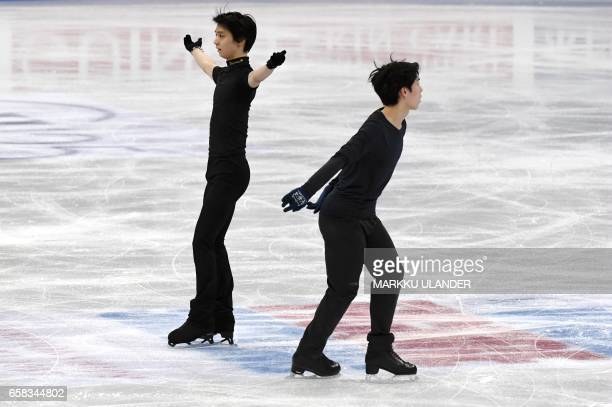 Yuzuru Hanyu and Keiji Tanaka of Japan perform during practice ahead of the ISU World Figure Skating Championships in Helsinki Finland on March 27...