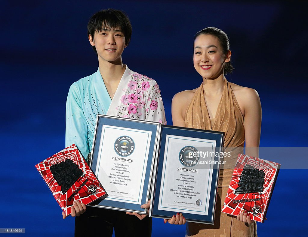 Yuzuru Hanyu (L) and <a gi-track='captionPersonalityLinkClicked' href=/galleries/search?phrase=Mao+Asada&family=editorial&specificpeople=247229 ng-click='$event.stopPropagation()'>Mao Asada</a> receive the Guinness World Record certificates of highest scores of short programs during the Stars On Ice at Yoyogi Gymnasium on April 11, 2014 in Tokyo, Japan.